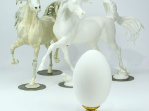 Egg next to Model Horses